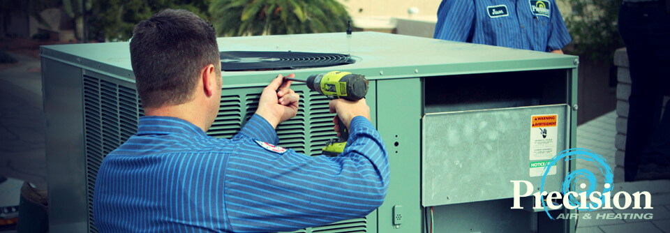 Precision | employee working on ac unit