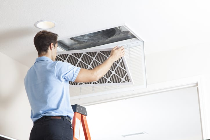 Precision | guy fixing ac vent