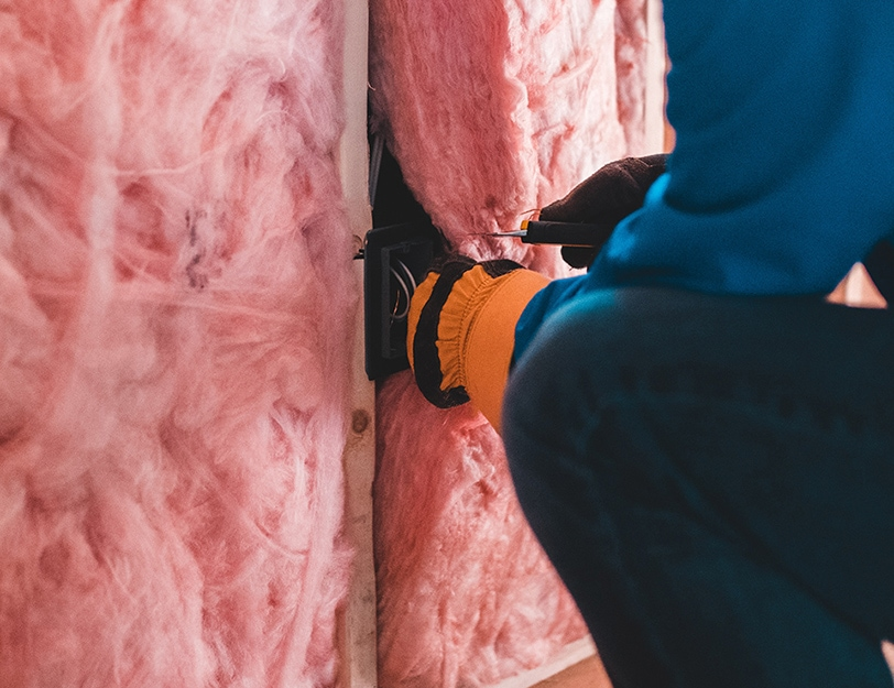 Precision | Worker putting in insulation