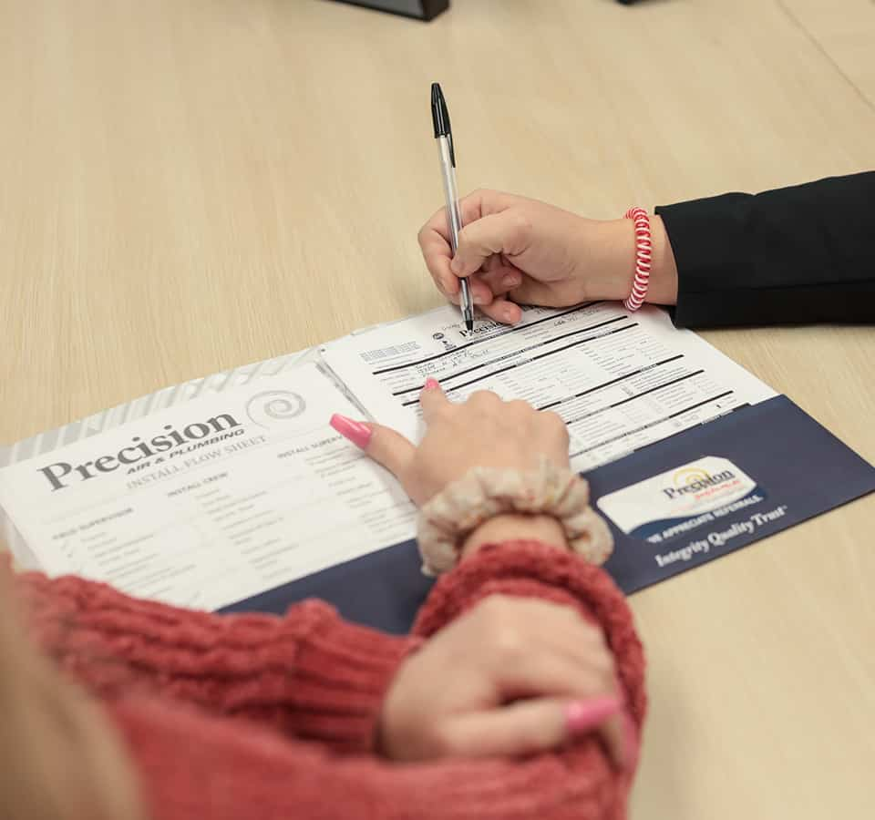 Precision | Two people looking at paperwork