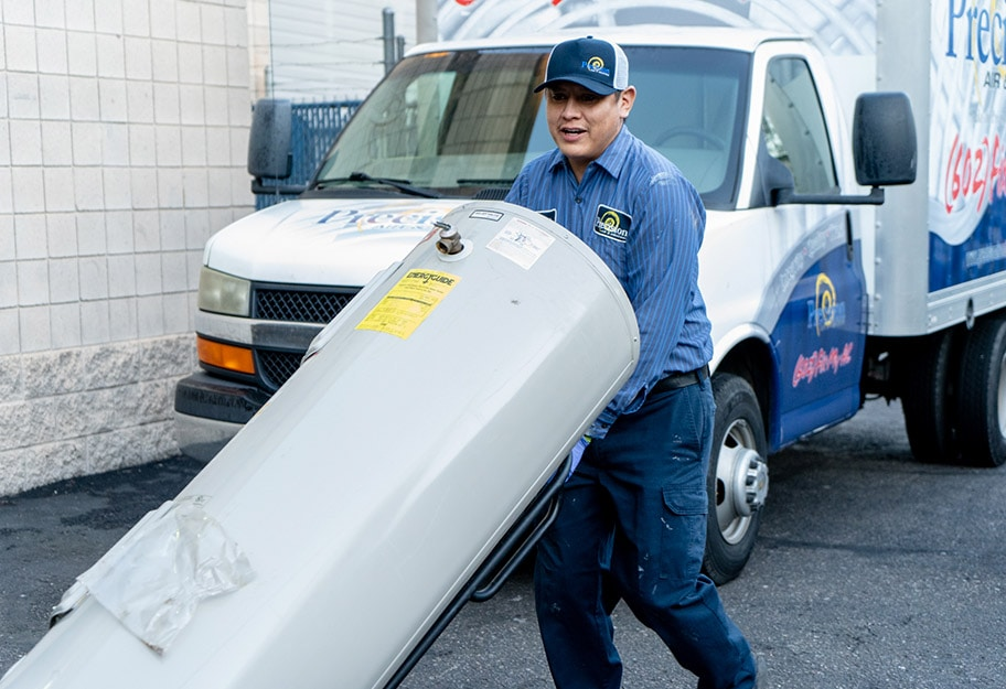 Precision | Worker moving a water heater