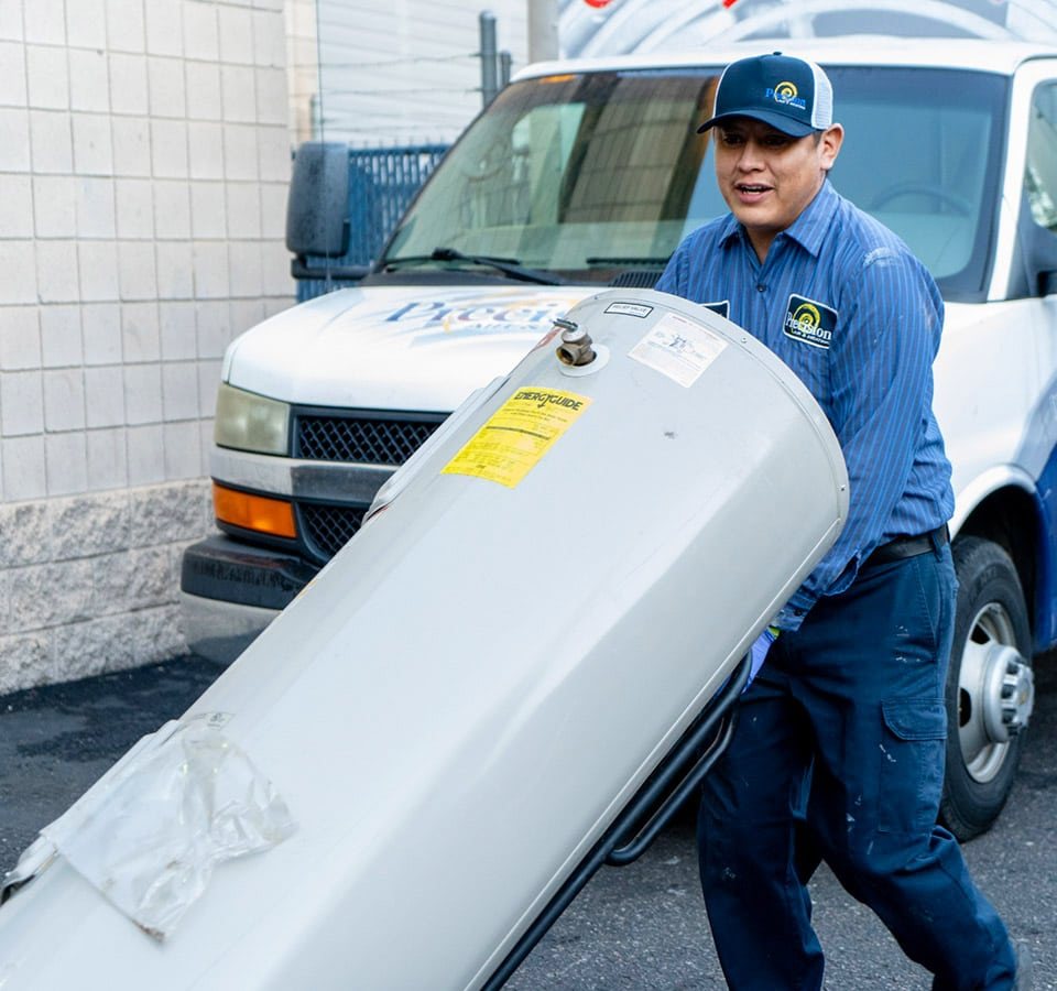 Precision Air & Plumbing | employee bringing out a water heater