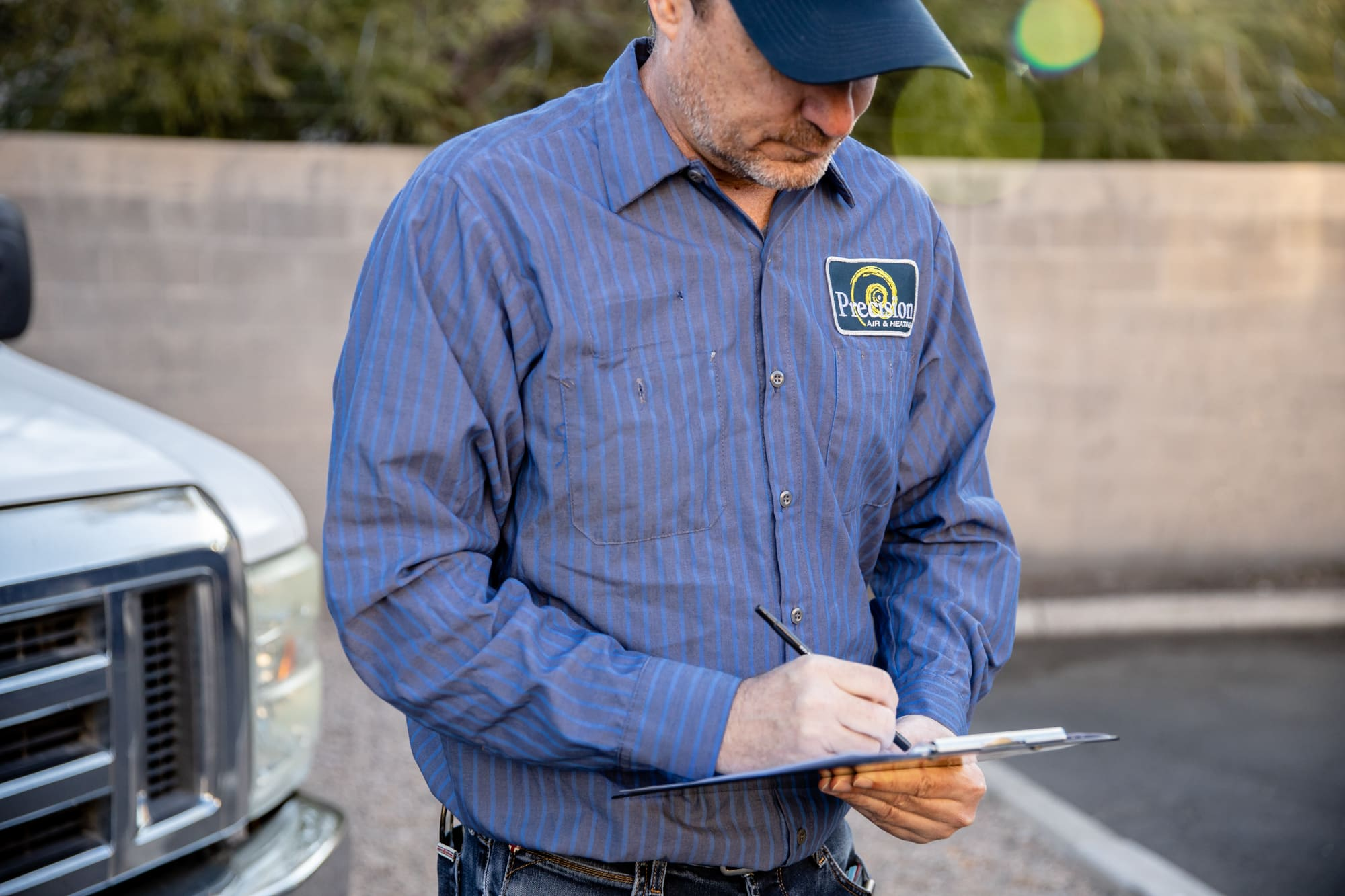 Precision Air & Plumbing | employee filling out a form